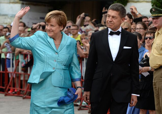 German Chancellor Angela Merkel (L) and her husband Joachim Sauer arrive for the opening of the Bayreuth Wagner Opera Festival with the production Tristan und Isolde at the opera house in the southern German city of Bayreuth on July 25, 2015