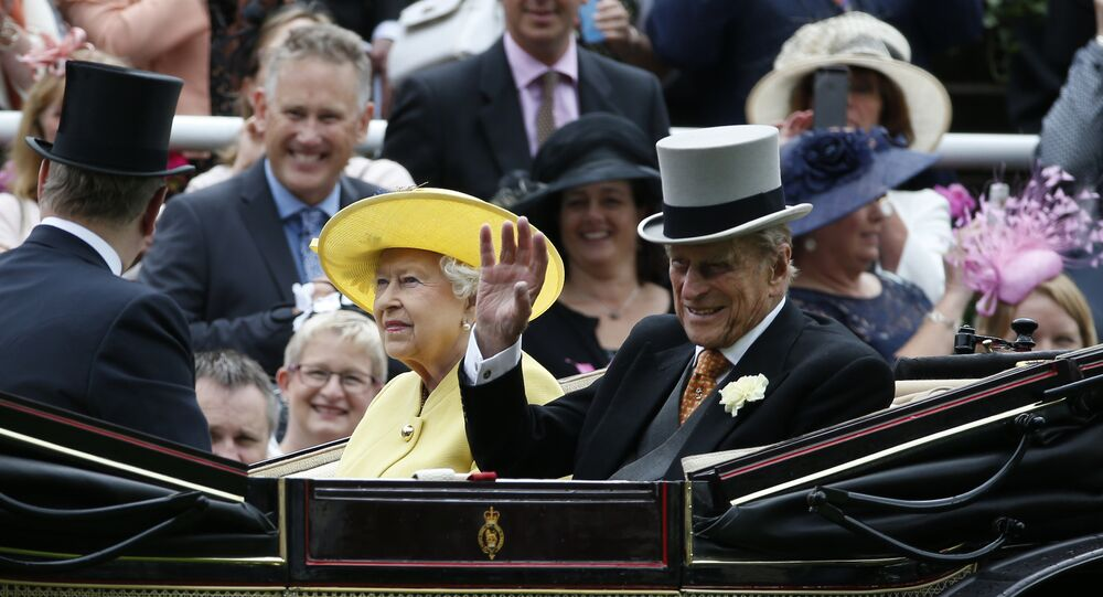 Britain's Queen Elizabeth II, looks up as Prince Philip, right, waves during their arrival by carriage on the first day of the Royal Ascot horse race meeting at Ascot, England, Tuesday, June, 14, 2016