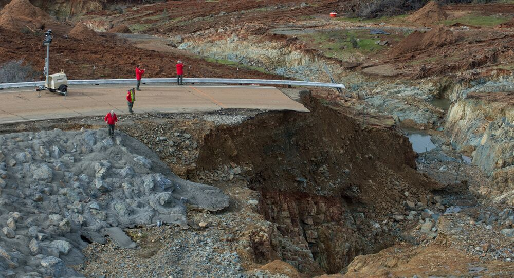 California Department of Water Resources crews inspect and evaluate the erosion just below the Lake Oroville Emergency Spillway site after lake levels receded, in Oroville, California, U.S., February 13, 2017