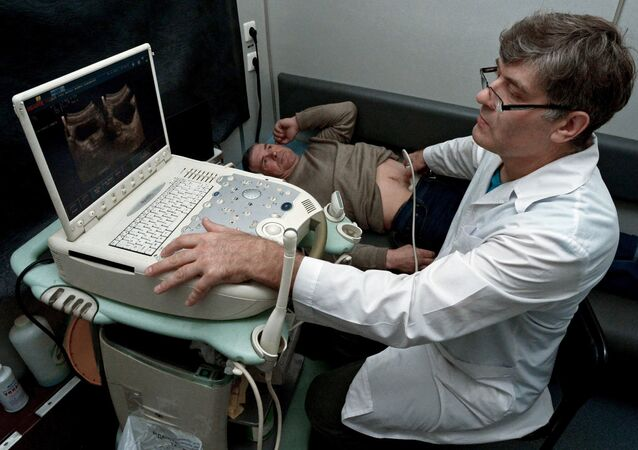 A doctor performs ultrasound scans in the ultrasound room