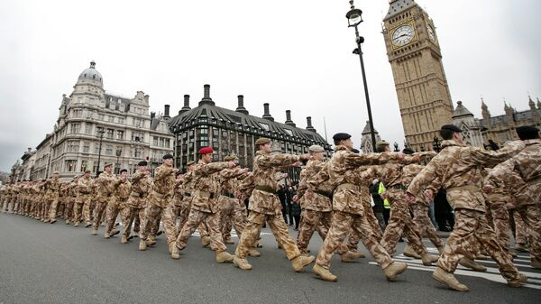 Soldiers from the British 7th Armoured Brigade who have returned from service on operations in Iraq march past Big Ben in London (File) - Sputnik International
