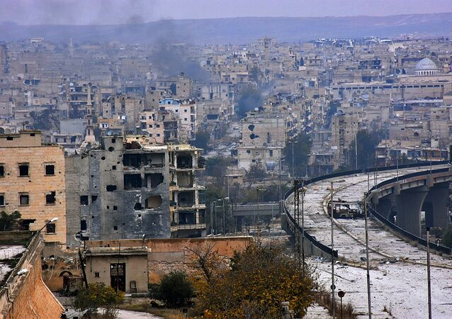 A picture taken on December 5, 2016 shows destroyed buildings in Aleppo's eastern al-Shaar neighbourhood as Syrian pro-government troops advance towards the area through Karm al-Jabal district during their offensive to retake Syria's second city