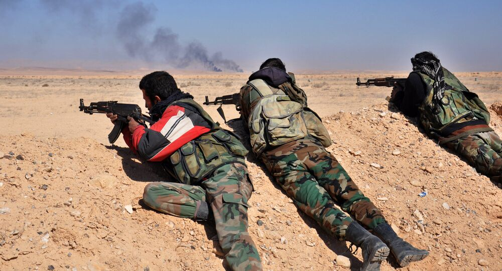 Syrian forces fire towards Daesh group positions.