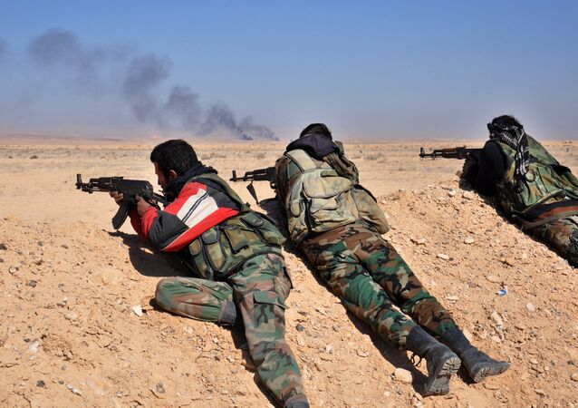 (File) Syrian army forces fire towards Islamic State group positions as they advance towards Hayyan oil field, east of the central Syrian Homs province on February 7, 2017