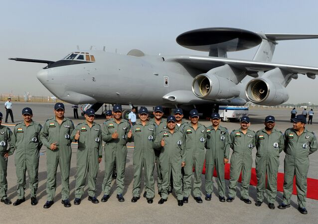 Indian Air Force (IAF) officers and crew of the Airborne Warning and Control System (AWACS) aeroplane pose for the media during the induction ceremony of the first AWACS equipped IL-76 aircraft at Air Foce station in New Delhi