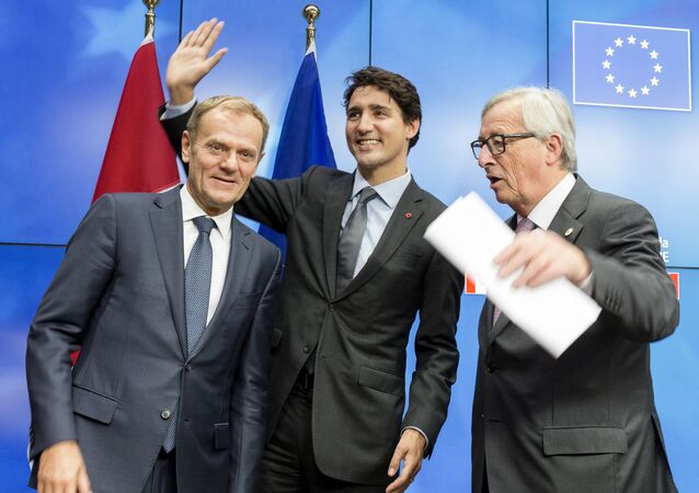 European Council President Donald Tusk, left, Canadian Prime Minister Justin Trudeau, center, and European Commission President Jean-Claude Juncker prepare to leave the room at the end of an EU-Canada summit at the European Council building in Brussels, Sunday, Oct. 30, 2016.