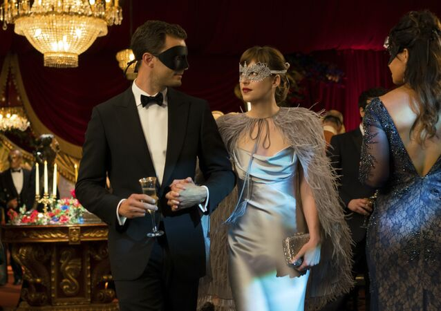 This image released by Universal Pictures shows Jamie Dornan as Christian Grey, left, and Dakota Johnson as Anastasia Steele in Fifty Shades Darker.