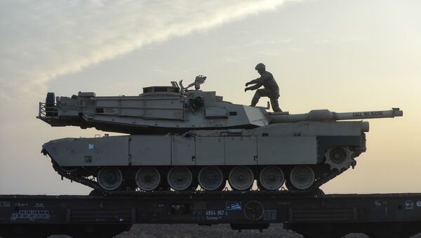 A serviceman of the Fighting Eagles 1st Battalion, 8th Infantry Regiment, walks on a tank that arrived via train to the US base in Mihail Kogalniceanu, eastern Romania, Tuesday, Feb. 14, 2017. Five hundred U.S. troops began to arrive in a Black Sea port in Romania with tanks and hardware to bolster defense in this East European NATO nation. - Sputnik International