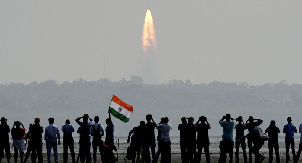 Indian onlookers watch the launch of the Indian Space Research Organisation (ISRO) Polar Satellite Launch Vehicle (PSLV-C37) at Sriharikota on Febuary 15, 2017
