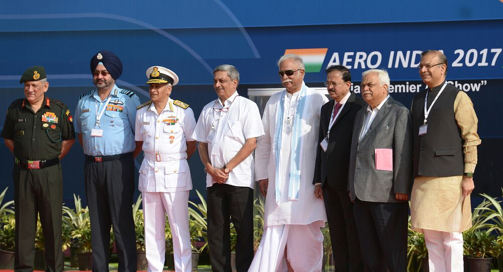 Indian Defense Minister Manohar Parrikar (4L), National Security Advisor Ajit Doval (3R), Air Chief Marshal of the Indian Air Force Birender Singh Dhanoa (2L) and other dignitaries pose on the inaugural day of the 11th edition of 'Aero India', a biennial air show and aviation exhibition, in Bangalore on February 14, 2017