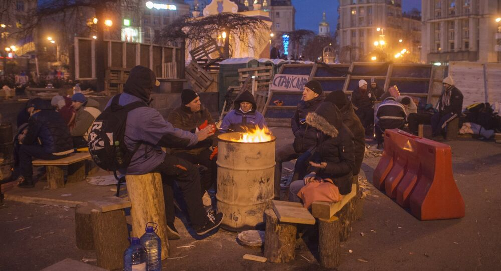EU integration supporters warm themselves at a campfire in Kiev's Independence Square
