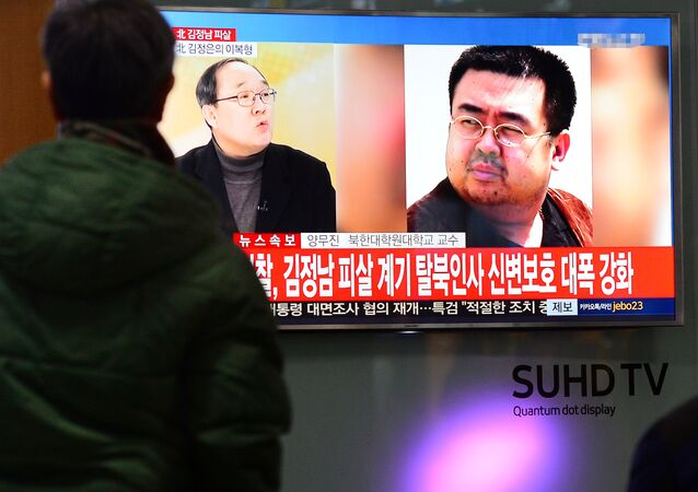 People watch a TV screen broadcasting a news report on the assassination of Kim Jong Nam, the older half brother of the North Korean leader Kim Jong Un, at a railway station in Seoul, South Korea, February 14, 2017