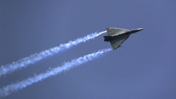 Indian Air Force indigenous Tejas Light Combat Aircraft displays its maneuverability during Air Force day parade at the Hindon air base on the outskirts of New Delhi, India, Saturday, Oct. 8, 2016 - Sputnik International