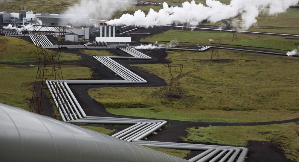 In this July 28, 2011 file photo, giant ducts carry superheated steam from within a volcanic field to the turbines at Reykjavik Energy's Hellisheidi geothermal power plant in Iceland.