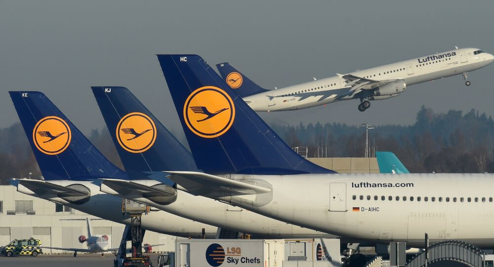 This file photo taken on November 29, 2016 shows airplanes of German airline Lufthansa parked in front of the Lufthansa terminal at the Franz-Josef-Strauss airport in Munich, southern Germany