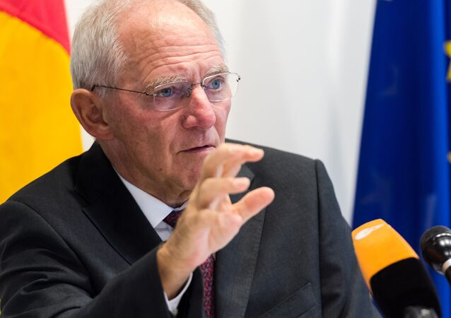 German Finance Minister Wolfgang Schauble addresses the media after a meeting of EU economy and finance ministers at the EU Council building in Luxembourg on Tuesday, Oct. 6, 2015.