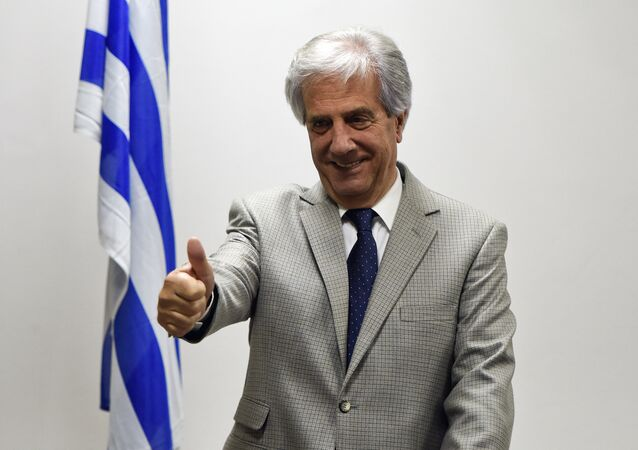 Uruguayan President-elect Tabare Vazquez gives the thumbs up sign during a press conference where he announced his cabinet picks for his next term in Montevideo, Uruguay, Tuesday, Dec. 2, 2014