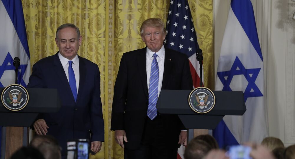 President Donald Trump and Israeli Prime Minister Benjamin Netanyahu participate in a joint news conference in the East Room of the White House
