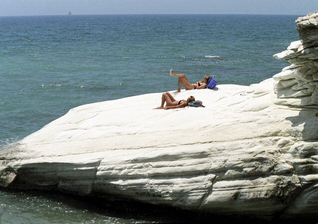 Holidaymakers on a beach in Cyprus.