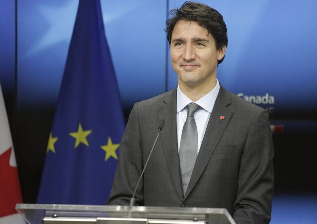 Canadian Prime Minister Justin Trudeau prepares to address a media conference at the end of an EU-Canada summit at the European Council building in Brussels, Sunday, Oct. 30, 2016.