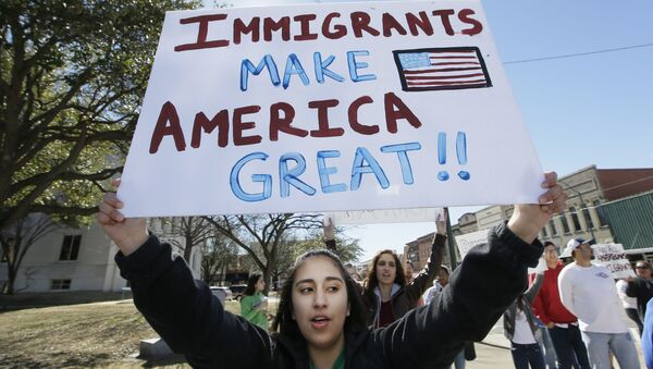 A protester holds a sign during a Day Without Immigrants Protest in Texas - Sputnik International