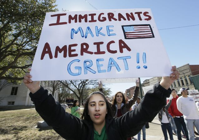 A protester holds a sign during a Day Without Immigrants Protest in Texas