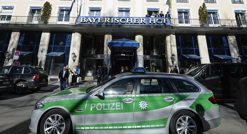 A police car passes the Bayerischer Hof hotel in Munich, southern Germany, on February 16, 2017. The Bayerischer Hof hotel will be the location for the 53rd Munich Security Conference (MSC) from February 17-19, 2017.