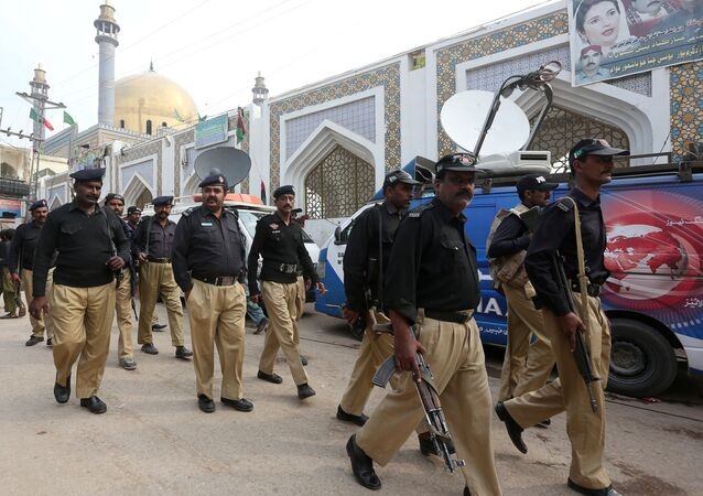 Policemen gather outside the tomb of Sufi saint Syed Usman Marwandi, also known as the Lal Shahbaz Qalandar shrine, after Thursday's suicide blast in Sehwan Sharif, Pakistan's southern Sindh province, February 17, 2017.
