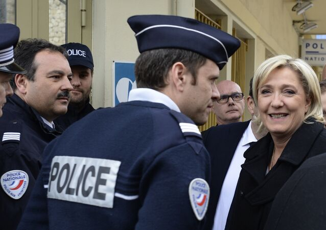 French far-right leader and presidential candidate Marine Le Pen smiles as she visits a border post Monday Feb. 13, 2017 in Menton, southern France, at the border with Italy.