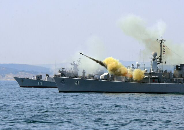 An anti-submarine rocket blasts off a rocket launcher from the Bulgarian navy frigate Drazki during the BREEZE 2014 military drill in the Black Sea