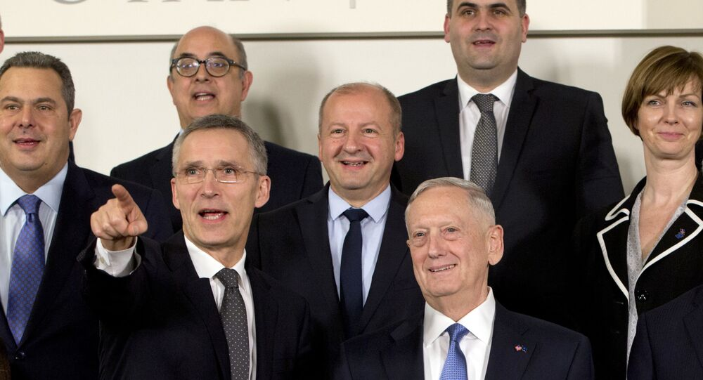 NATO Secretary General Jens Stoltenberg, front left, and U.S. Secretary of Defense Jim Mattis, front left, stand with other NATO defense ministers during a group photo at NATO headquarters in Brussels on Wednesday, Feb. 15, 2017.