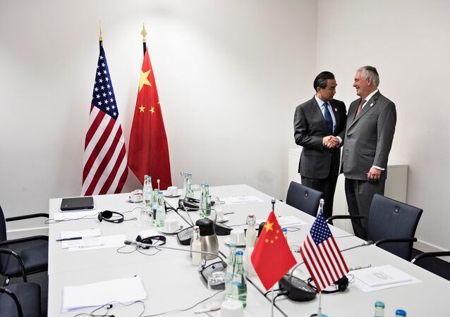 US Secretary of State Rex Tillerson (R) is greeted by China's Foreign Minister Wang Yi before a meeting at the World Conference Center February 17, 2017 in Bonn, western Germany.