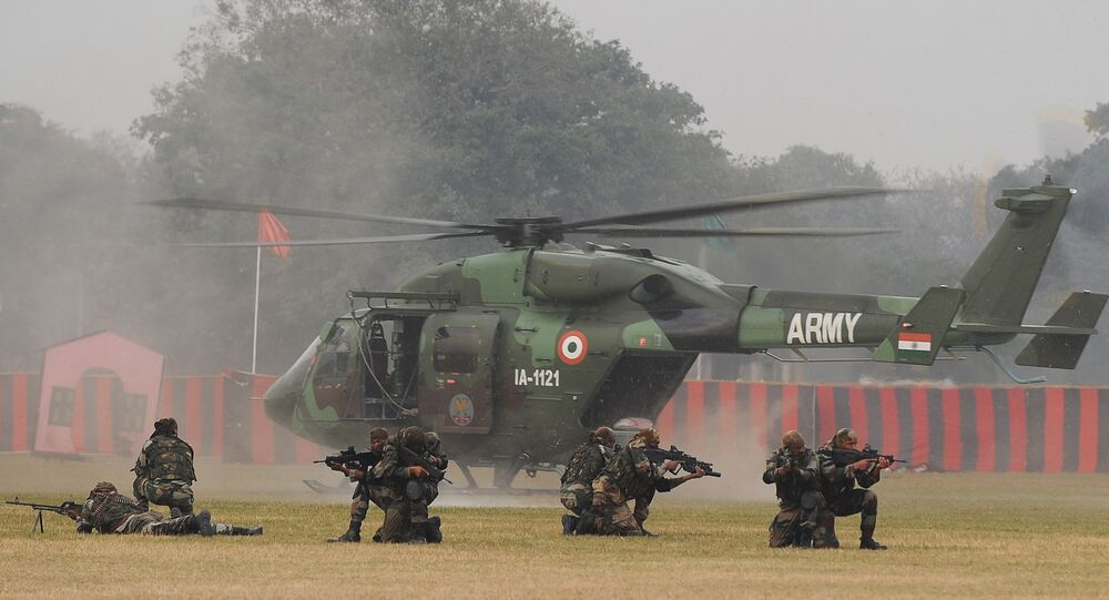 Soldiers take position while performing a drill after alighting from an HAL Dhruv helicopter during an Army weaponry exhibition in Kolkata. (File)