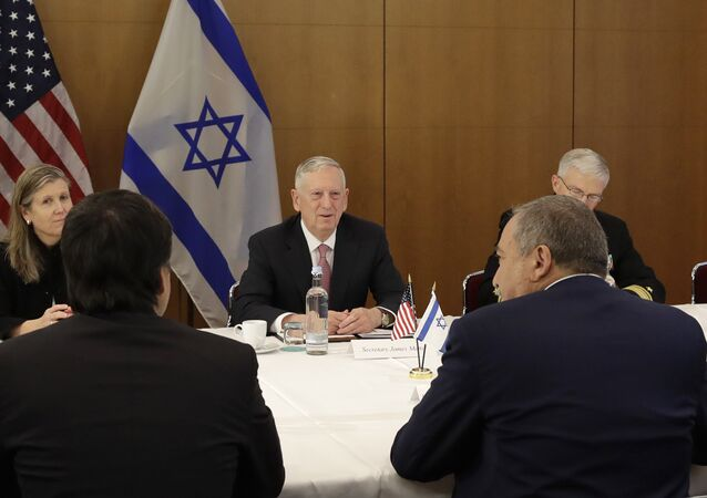 U.S. Secretary of Defense Jim Mattis, center, talks to Israeli Defence Minister Avigdor Lieberman prior to the Munich Security Conference in Munich, southern Germany