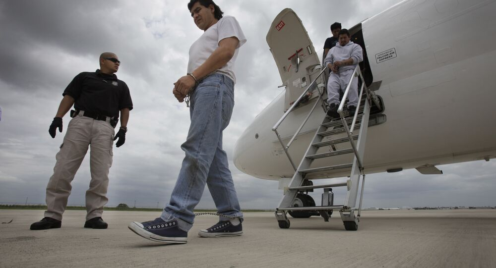 FILE - In this May 25, 2010 file photo, Mexican immigrant Javier Castillo, center, walks on the tarmac after he was flown from Chicago to Harlingen, Texas for deportation by U.S. Immigration and Customs Enforcement.