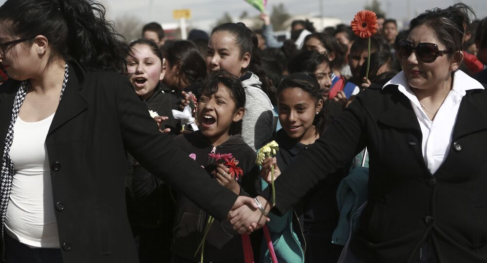 Mexicans join hands to form a symbolic human wall along the Rio Grande, which marks the border between Mexico and the U.S. in Ciudad Juarez, Friday, Feb. 17, 2017.
