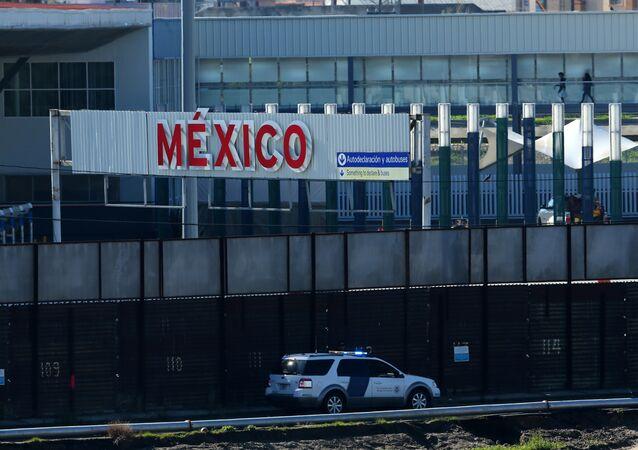 A U.S. border patrol vehicle drives along the border wall between Mexico and the United States in San Ysidro, California, U.S.
