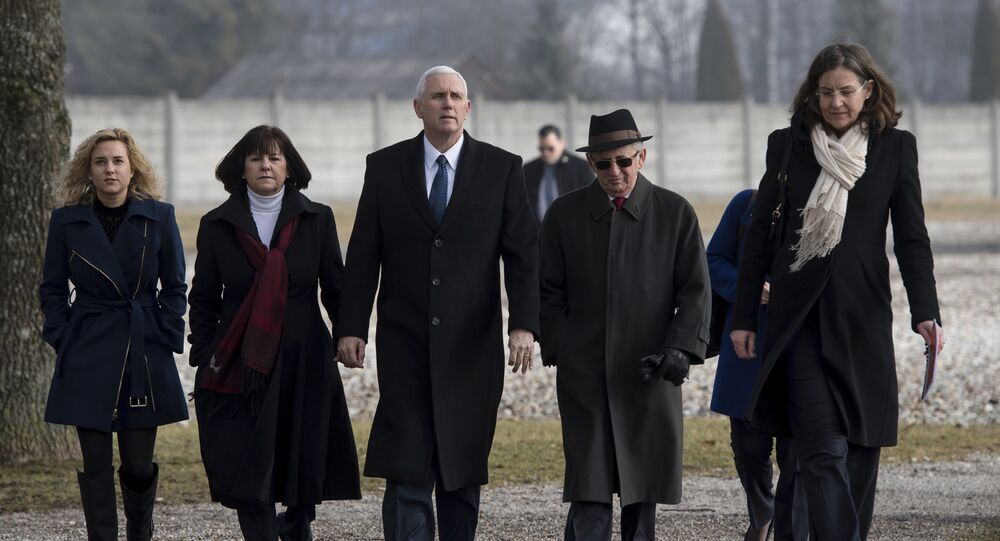 US Vice President Mike Pence, center, his wife Karen, second from left, and his daughter Charlotte, left, are lead by Holocaust survivor Abba Naor, second from right, as they visit the former Nazi concentration camp in Dachau near Munich, southern Germany, Sunday, Feb. 19, 2017, one day after he attended the Munich Security Conference.