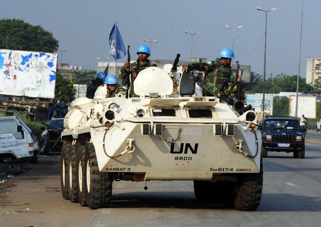 Bangladeshi UN peacekeepers patrol the Abobo neighbourhood in Abidjan on December 27, 2010