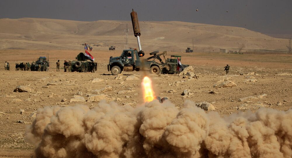 Members of the Iraqi rapid response forces fire a missile toward Islamic State militants during a battle in the south of Mosul, Iraq February 19, 2017