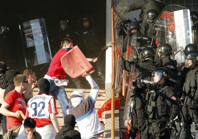Serbian riot police officers clash with Red Star fans during the Serbian Super league derby match between Red Star and Partizan Belgrade at the Rajko Mitic stadium in Belgrade, on April 25, 2015