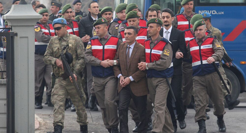 Zekeriya Kuzu, one of the main suspects accused of attempting to assassinate Turkish President Tayyip Erdogan on the night of the failed last year's July 15 coup, and the other soldiers are escorted by Turkish gendarmes as they arrive for the first hearing of the trial in Mugla, Turkey, February 20, 2017