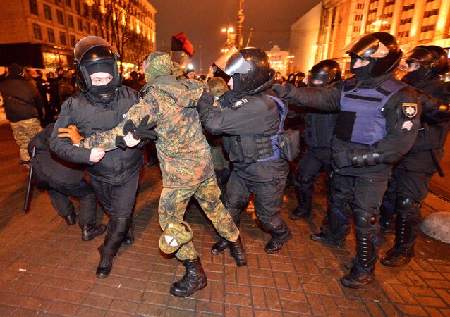 Police detain a protester during a rally against trade with Ukraine's rebel-held eastern areas in the Donetsk and Luhansk regions, in central Kiev, Ukraine February 19, 2017
