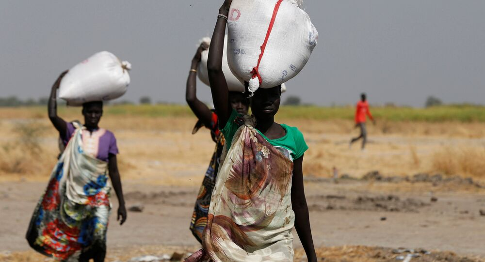 Women carry sacks of food in Nimini village, Unity State, northern South Sudan, February 8, 2017