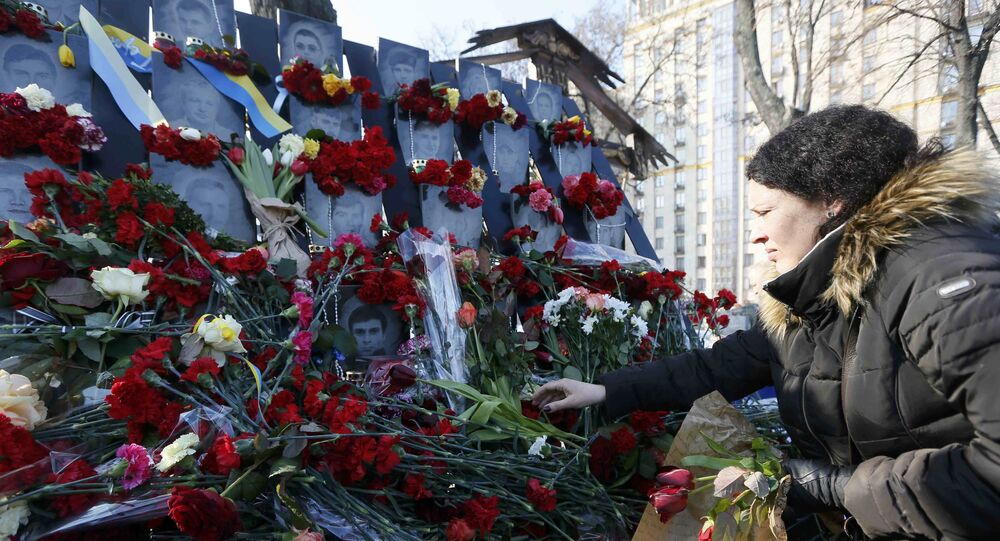 A woman places flowers at the monument of the so-called Nebesna Sotnya (Heavenly Hundred), the anti-government protesters killed during the mass protests in 2014, during a rally commemorating the third anniversary of protests, in central Kiev, Ukraine February 20, 2017