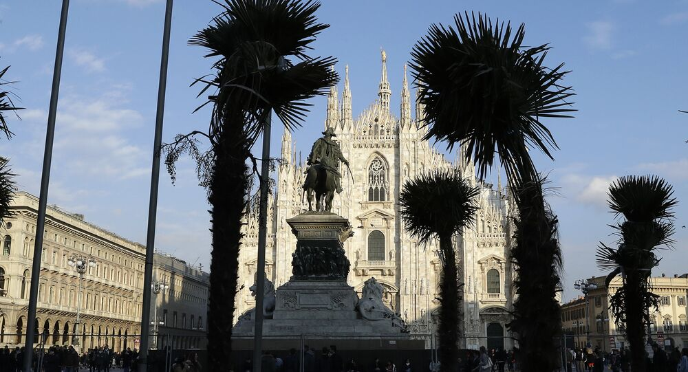 Palm trees are planted in flowerbed in front of Milan's gothic-era Duomo Cathedral, Italy, Friday, Feb. 17, 2017.