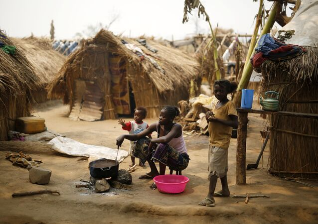Christian families living in a refugee camp prepare food in Kaga-Bandoro, Central African Republic, Tuesday Feb. 16, 2016