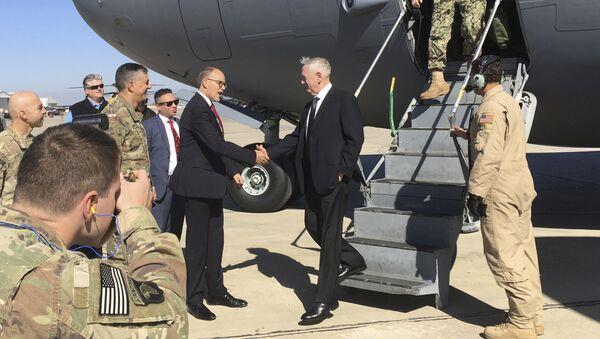 U.S. Secretary of Defense Jim Mattis, center, is greeted by U.S. Ambassador Douglas Silliman as he arrives at Baghdad International Airport on an unannounced trip Monday, Feb. 20, 2017. - Sputnik International