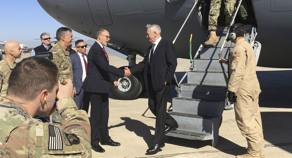 U.S. Secretary of Defense Jim Mattis, center, is greeted by U.S. Ambassador Douglas Silliman as he arrives at Baghdad International Airport on an unannounced trip Monday, Feb. 20, 2017.