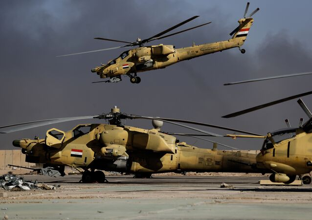 An Iraqi airforce Mi-28 helicopter takes off in front of Mi-35 (R) and Mi-28 helicopters at the army base of Qaryat Jaddalat, south of the city of Mosul on November 25, 2016